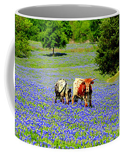 Coffee Mug featuring the photograph Cows In Texas Bluebonnets by Kathy White