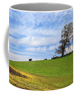 Coffee Mug featuring the photograph Cows On A Spring Hill by James Eddy