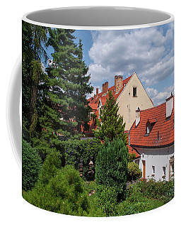 Coffee Mug featuring the photograph Cozy Prague by Jenny Rainbow