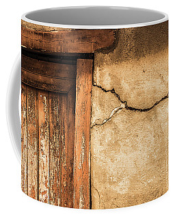 Coffee Mug featuring the photograph Cracked Lime Stone Wall And Detail Of An Old Wooden Door by Semmick Photo