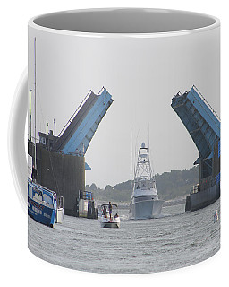 Coffee Mug featuring the photograph Cruising In Under The Bridge by Robert Banach