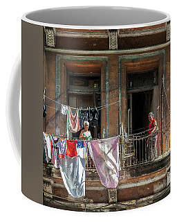 Coffee Mug featuring the photograph Cuban Women Hanging Laundry In Havana Cuba by Charles Harden
