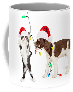 Cute Kitten And Puppy Playing With Christmas Lights Coffee Mug