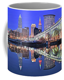 Coffee Mug featuring the photograph Cuyahoga River Blue Hour by Frozen in Time Fine Art Photography