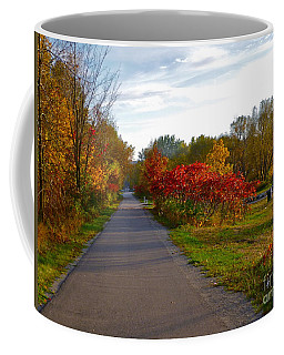 Coffee Mug featuring the photograph Cycling In Heaven by Claire Bull