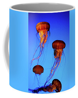Coffee Mug featuring the photograph Dancing Jellyfish by Anthony Jones