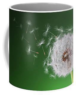 Dandelion Flying On Background Green Coffee Mug by Bess Hamiti