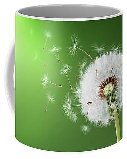 Coffee Mug featuring the photograph Dandelion Seeds by Bess Hamiti