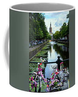 Coffee Mug featuring the photograph Canal And Decorated Bike In The Hague by RicardMN Photography