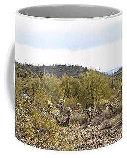 Coffee Mug featuring the photograph Desert Sunrise by Phyllis Denton