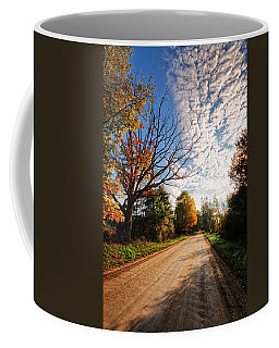 Coffee Mug featuring the photograph Dirt Road And Sky In Fall by Lars Lentz