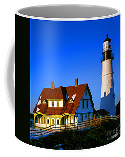 Coffee Mug featuring the photograph Dollhouse Portland Head Light by Olivier Le Queinec
