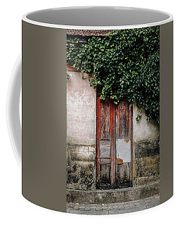 Coffee Mug featuring the photograph Door Covered With Ivy by Marco Oliveira