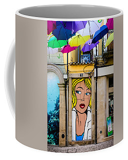 Door No 73 And The Floating Umbrellas Coffee Mug by Marco Oliveira