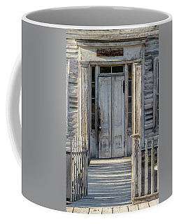 Door Of The Old Bannack Schoolhouse And Masonic Temple Coffee Mug