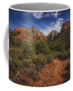 Coffee Mug featuring the photograph Dramatic Cloudscape Over Capitol Butte by Andy Konieczny