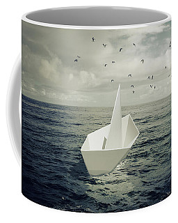 Coffee Mug featuring the photograph Drifting Paper Boat by Carlos Caetano
