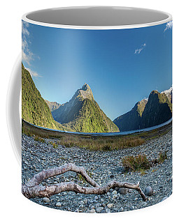 Coffee Mug featuring the photograph Driftwood In Milford Sound by Gary Eason