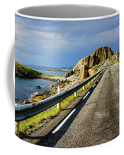 Coffee Mug featuring the photograph Driving Along The Norwegian Sea by Dmytro Korol