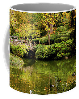 Coffee Mug featuring the photograph Ducks In Summertime by Iris Greenwell