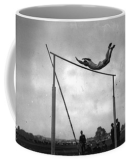 Coffee Mug featuring the painting Ed Cook In The Pole Vault by Artistic Panda