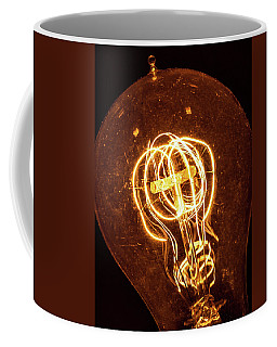 Coffee Mug featuring the photograph Electricity Through Tungsten by T Brian Jones