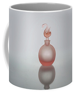 Coffee Mug featuring the photograph Elegant Frosted Pink Vintage Perfume Bottle by David and Carol Kelly