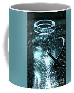 Coffee Mug featuring the photograph Elixar by Stephen Mitchell
