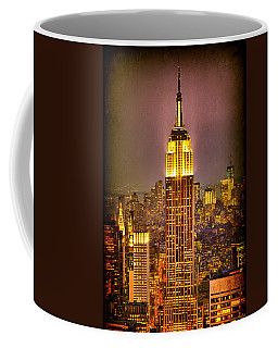 Coffee Mug featuring the photograph Empire Light by Chris Lord