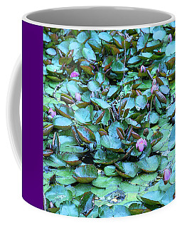 Coffee Mug featuring the photograph Painted Water Lilies by Theresa Tahara