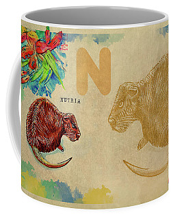 Coffee Mug featuring the drawing English Alphabet , Nutria by Ariadna De Raadt