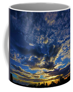 Coffee Mug featuring the photograph Erupting Sunset by Mark Blauhoefer