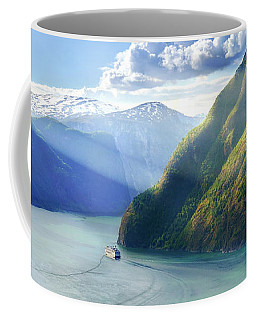 Coffee Mug featuring the photograph Evening Over Geirangerfjord by Dmytro Korol