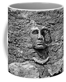 Face In Stone Coffee Mug