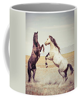 Coffee Mug featuring the photograph Fighting Stallions by Mary Hone