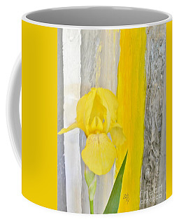 First Yellow Iris Coffee Mug by Marsha Heiken