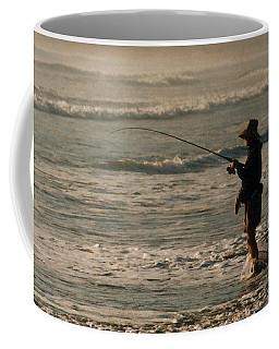 Coffee Mug featuring the photograph Fisherman by Steve Karol