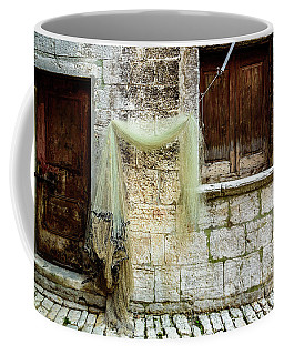 Fishing Net Hanging In The Streets Of Rovinj, Croatia Coffee Mug