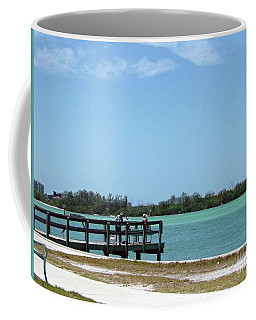 Coffee Mug featuring the photograph Fishing Pier by Gary Wonning