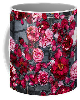 Coffee Mug featuring the photograph Floating Camelia Blossoms by Ann Jacobson