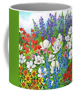 Coffee Mug featuring the painting Floral Fusion by Val Stokes