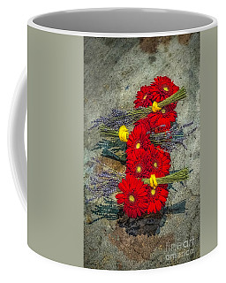 Coffee Mug featuring the photograph Flowers On Rocks by Nick Zelinsky