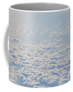 Coffee Mug featuring the photograph Flying Among The Clouds by Bill Cannon
