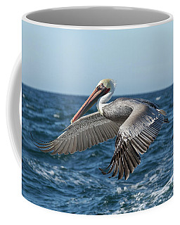 Coffee Mug featuring the photograph Flying Brown Pelican by Robert Bales