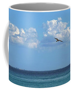 Coffee Mug featuring the photograph Flying By The Sea by Francesca Mackenney