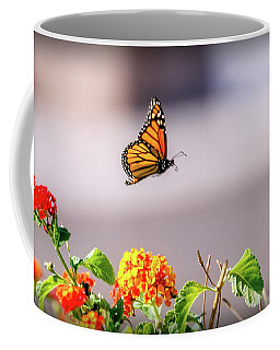 Flying Monarch Butterfly Coffee Mug by Robert Bales