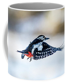 Coffee Mug featuring the photograph Flying Woodpecker by Torbjorn Swenelius