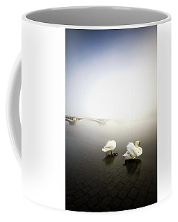 Foggy Morning View Near Bridge With Two Swans At Vltava River, Prague, Czech Republic Coffee Mug