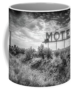Coffee Mug featuring the photograph Forgotten Motel Sign by Spencer McDonald