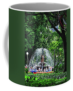 Coffee Mug featuring the photograph Fountain Through The Trees By Kaye Menner by Kaye Menner